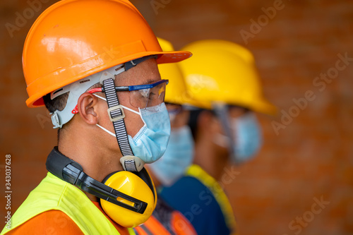 Obraz Technician wear protective face masks safety for Coronavirus Disease 2019 (COVID-19) in machine industrial factory,Coronavirus has turned into a global emergency. - fototapety do salonu