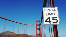 Speed Limit Sign On Golden Gate Bridge Against Clear Blue Sky On Sunny Day