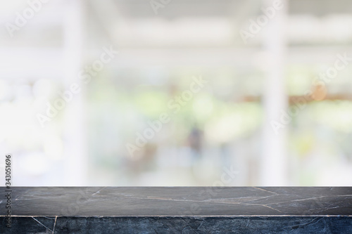 Fototapeta Empty black marble stone table top and blur glass window interior cafe and restaurant banner mock up abstract background - can used for display or montage your products. obraz