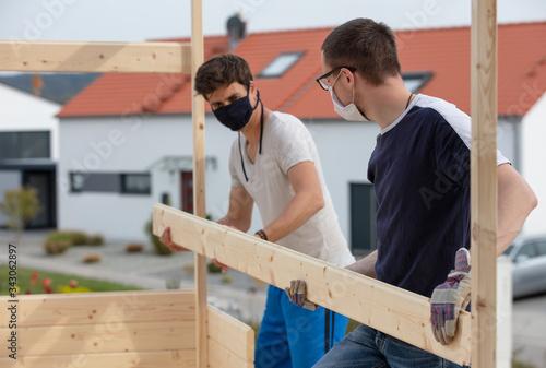 Photo Mit Mundschutz am Bau