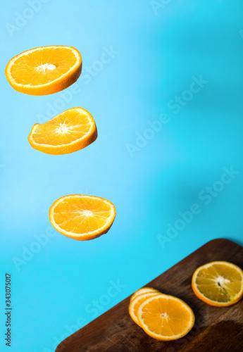 Orange sliced in the air Canvas Print