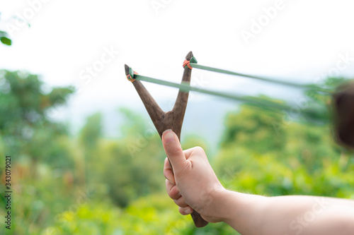 Person Holding Catapult Against Sky Tapéta, Fotótapéta