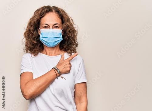 Tela Middle age woman wearing coronavirus protection mask for covid-19 epidemic virus