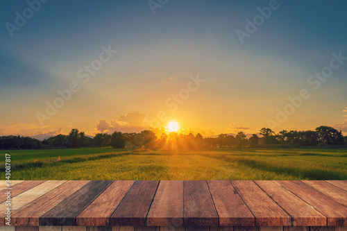 Fototapeta Rice field sunset and Empty wood table for product display and montage