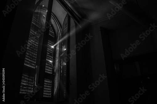 Low Angle View Of Sunbeam From Broken Window Blinds Canvas Print