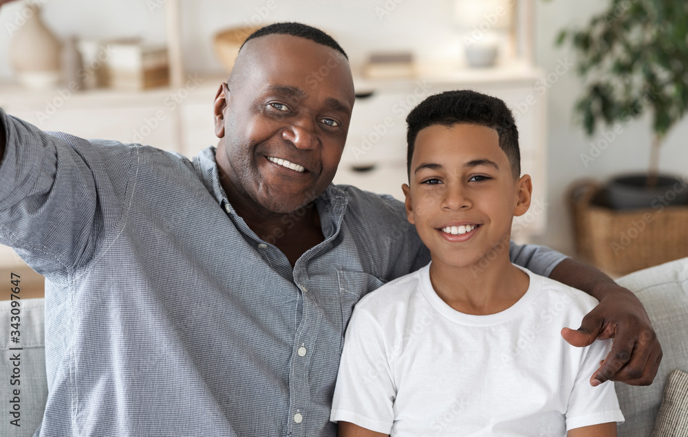 Fototapeta Selfie With Grandfather. Happy black granddad and grandson taking photo together
