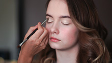 Girl Makeup Artist Paints The Eyes Of A Young Girl
