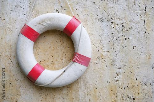 Fototapeta life buoy on wooden background