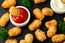 Crispy Battered Scampi Nuggets With Ketchup And Mayonnaise On Rustic Stone Board.