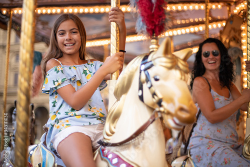 Valokuvatapetti Celebration of happy days at the fair with merry go round