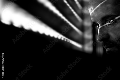 Fotografía Close-up Of Thoughtful Man By Window In Darkroom