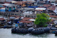 View Of Nigerian Village With Fenders