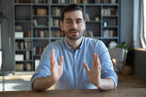 Carta da parati Head shot portrait confident businessman coach wearing glasses looking at camera