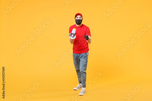 Delivery man in red cap blank t-shirt uniform mask gloves isolated on yellow bac Canvas Print