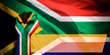canvas print picture - Banner of Flag of South Africa painted on male fist, fist flag, country of South Africa, strength, power, concept of conflict. On a blurred background
