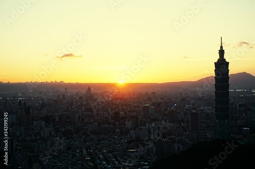Taipei 101 In City Against Orange Sky Canvas Print