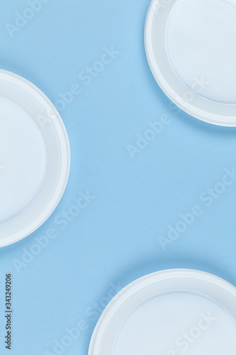 Disposable plastic dishes, plates, blue background, copy space Wallpaper Mural