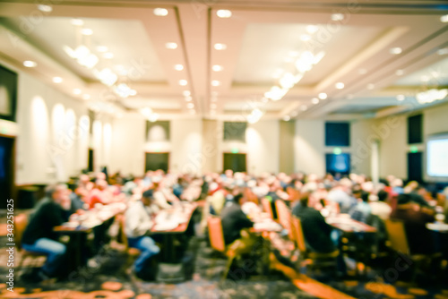 Motion blurred side view diverse people attend investing workshop at conference Canvas Print