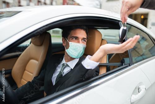 Fototapeta Masked man taking the car keys obraz