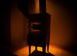 Fire burning in small black iron stove. Closeup photo with selective focus