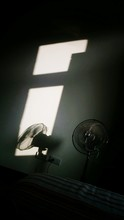 Electric Fan With Shadow On Wall At Home