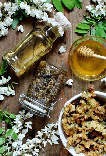 products from white acacia - honey, syrup from acacia, jam, acacia flowers in batter Canvas Print