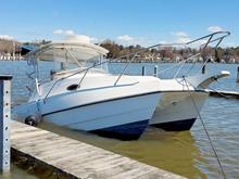 Sinking White Catamaran Boat In Boat Slip