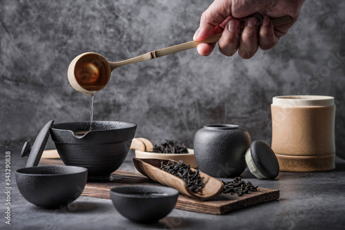 Leinwand Poster Ceramic tea pot and cups with the famous Photo in the room Chinese tea ceremony