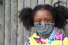 Girl Wearing Cloth Face Mask O...