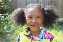 Happy African American Girl Mi...