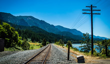 Railroad Track By Mountains Against Clear Sky