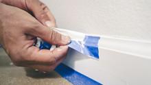 Painter Man Removing Masking B...
