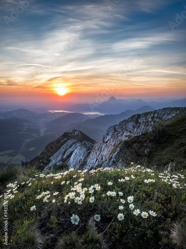Photo Scenic View Of Mountains Against Sky During Sunset