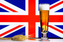 A Lager Style Beer In A Tall Glass With A Wheat Or Barley Sheaf And A British Union Jack Flag Background.