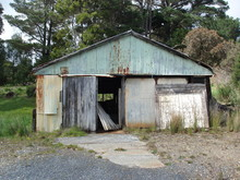 Old Abandoned Tin And Timber Shed In Strahan