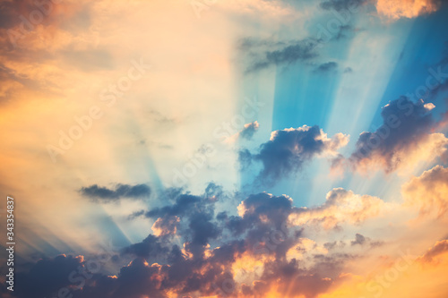 Obraz Sunset dramatic sky clouds with sunbeam - fototapety do salonu