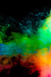 Abstract art powder paint on black background. Movement abstract frozen dust explosion multicolored on black background.