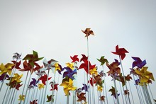 Low Angle View Of Colorful Pinwheel Toys Against Clear Sky
