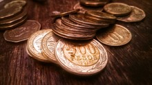 Close-up Of Coins On Wooden Ta...