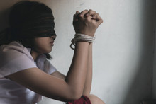 Kidnapped Young Girl Tied With...