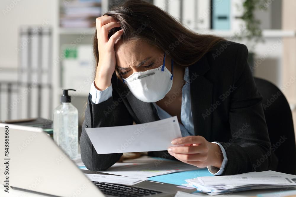 Fototapeta Sad executive with mask complaining looking receipt