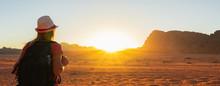 Woman Enjoying The Beautiful Sunset In The Wadi Rum Desert In Jordan. Banner.