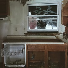 Abandoned Kitchen With Broken Window Glass