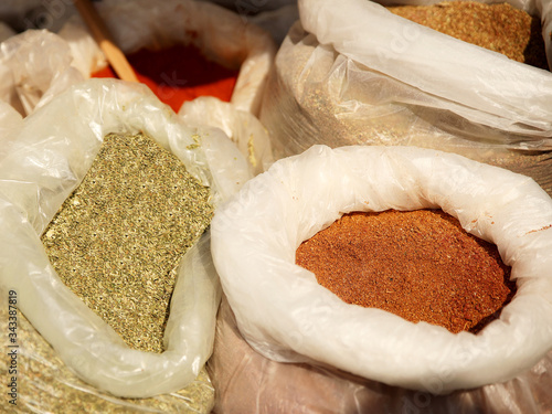 Photo Sale of friable cereals and seasonings in open bags on a bazaar counter