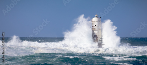 Cuadros en Lienzo The lighthouse of the boat-eater shrouded by the waves of a mistral wind storm