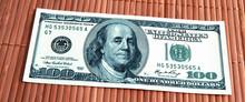 A Hundred Dollars Bill In Clos...