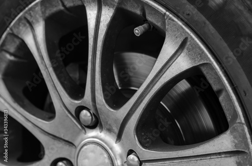 Alloy wheel with dirt and oil. Canvas Print