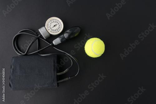 Photo black manual blood pressure monitor on black background for measuring pressure a