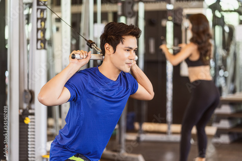 Valokuva Young Asian man wearing sportswear doing excecise with the bar in gym fitness sp
