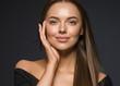 Leinwandbild Motiv Female face beauty woman long hair fly natural make up clean healthy skin hand touching face